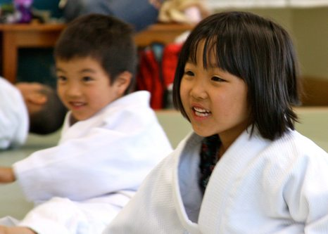 Two students smiling during Ann Arbor Kids Karate class