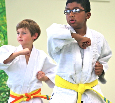 Two Ann Arbor Kids Karate students practicing kata